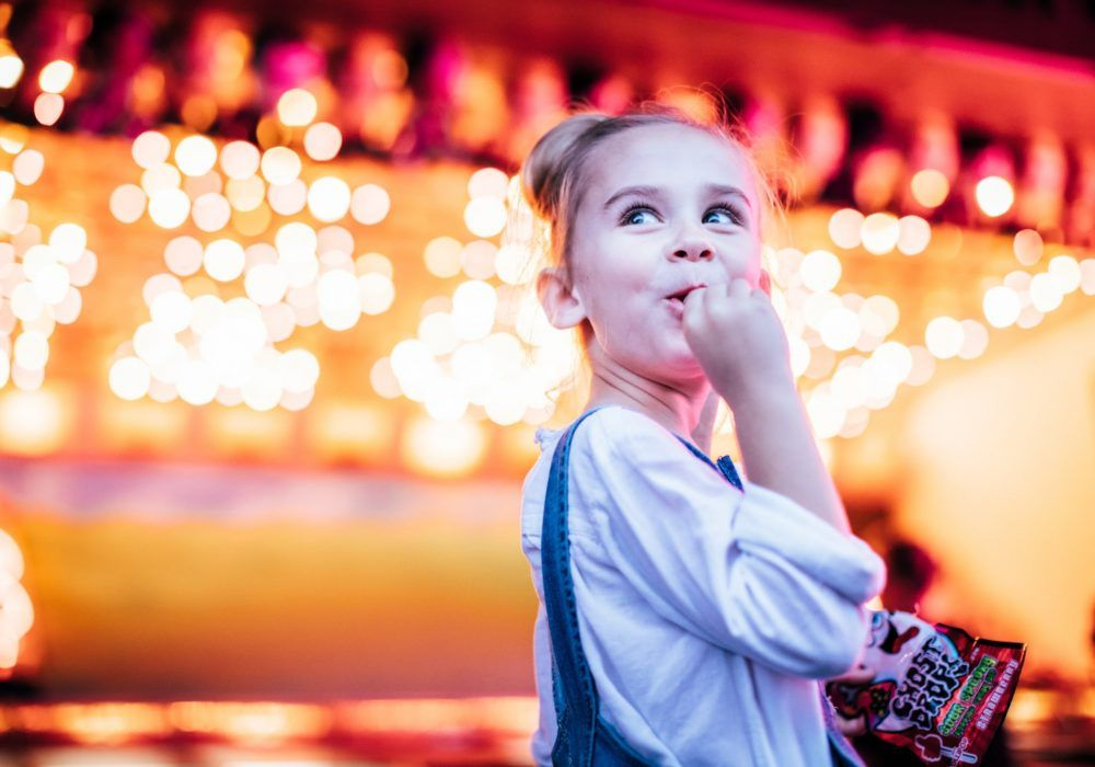 young-girl-eating-lolly-at-movie-world